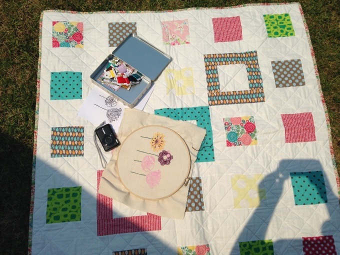 Embroidering in the Spring sun upon my Small Plates Lap Quilt